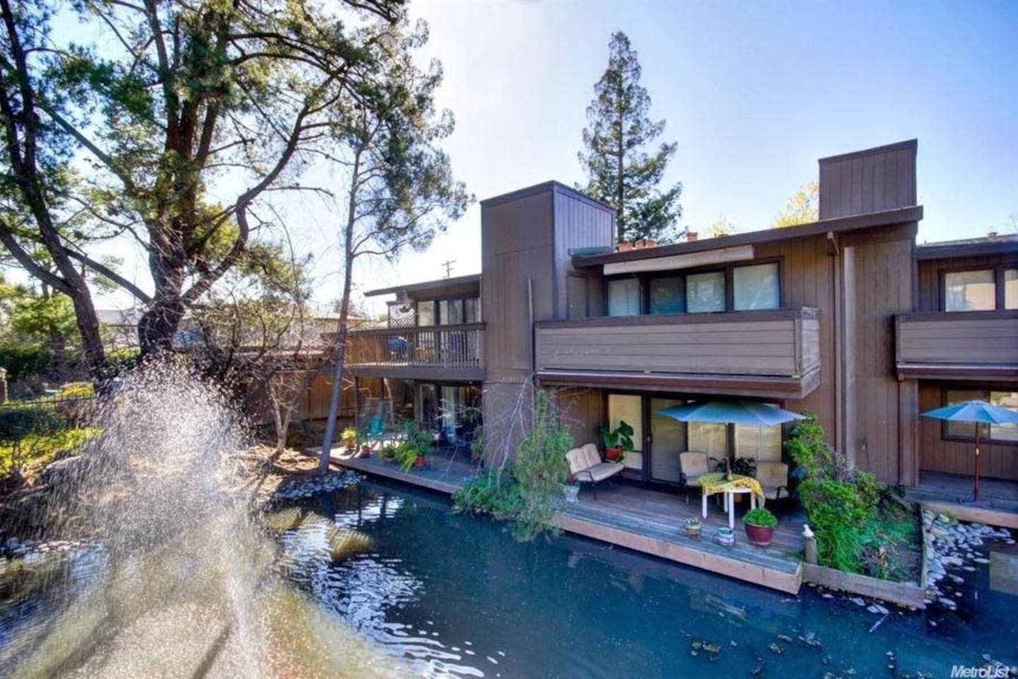 Spacious beautiful Condo facing water feature with Koi and ducks.