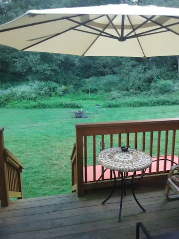 Back deck/ commonspace yard fire pit 11' umbrella