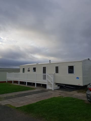 8 berth caravan on Craig Tara with decking area