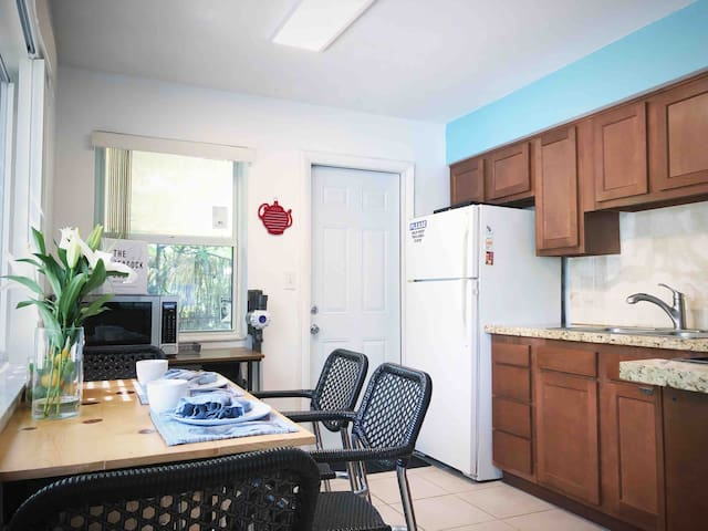 Kitchen with Microwave, seating area for 4 people.