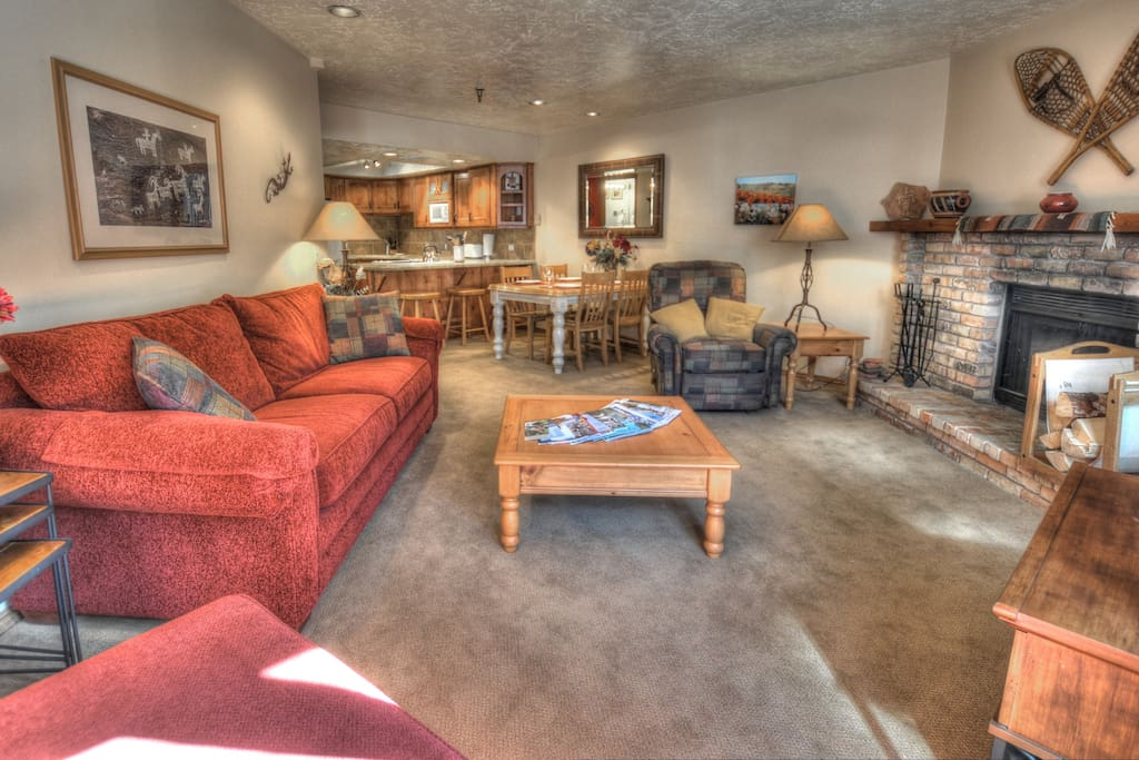 Living Room - wood-burning fireplace, plenty of seating, HD TV with Comcast cable, Queen sleeper sofa
