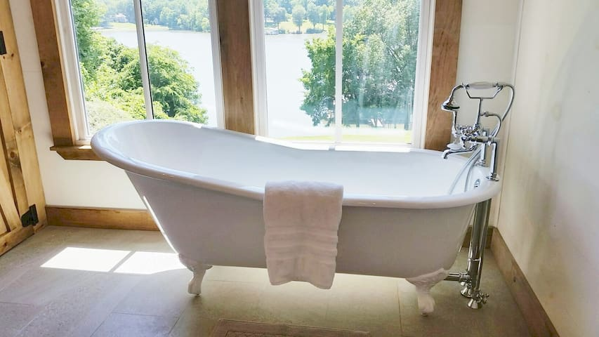 Relaxing claw foot tub over looking the lake