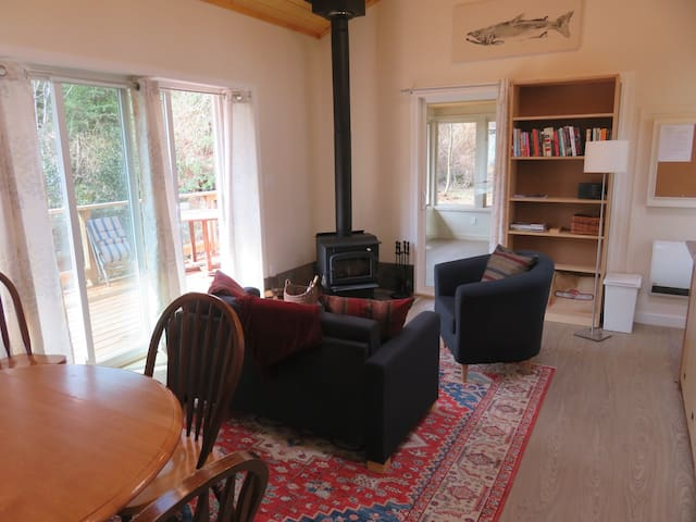 Cosy living room with wood stove. Living room opens onto a spacious and sunny deck.