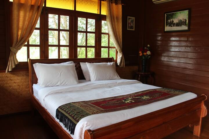 Traditional Thai style cabin with the river view
