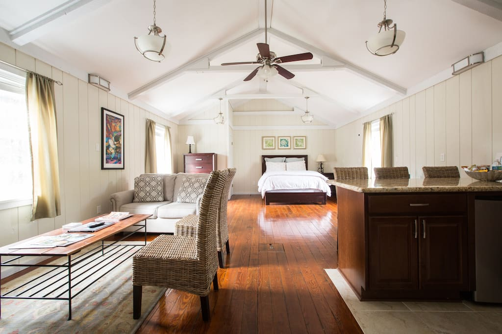 The guest suite features a queen sized bed, TV and sitting area, kitchenette (with mini fridge, stove top, microwave, sink, and dishwasher), and an ensuite full bath.  The room is spacious and large enough to accommodate extra air mattresses.