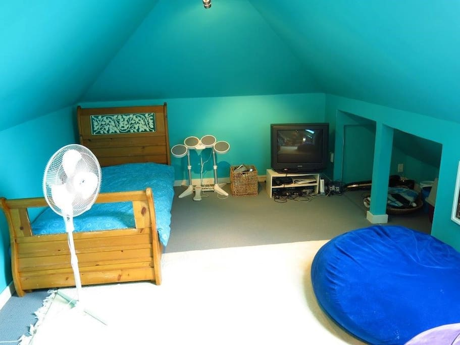 Attic space-full length of the house- perfect hangout for kids and teenagers