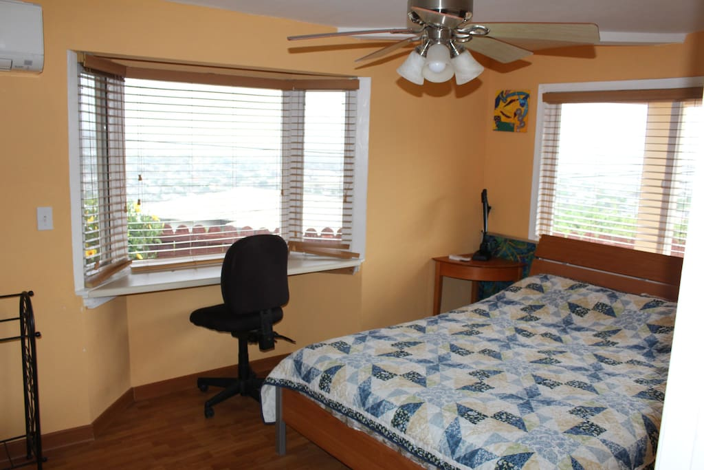 1st bedroom with a queen bed