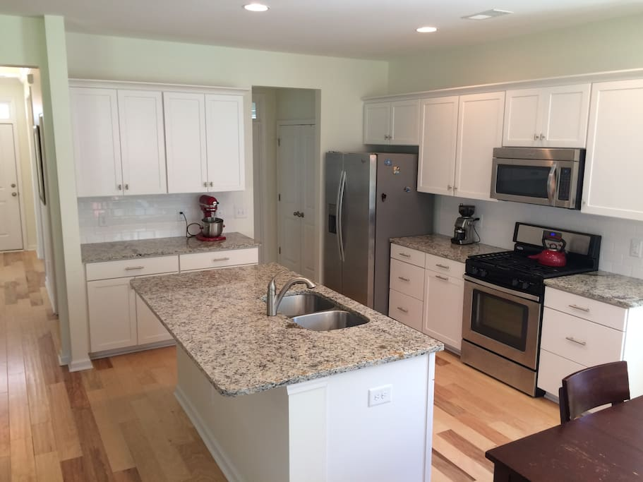 Clean, well equipped kitchen and open eating area