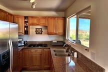 The Kitchen - coffee maker, kettle, microwave, cooktop, large counter oven, outdoor charcoal grill, all you'd need to cook!