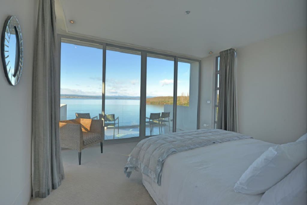 Master bedroom with incredible lake views, balcony and ensuite bathroom