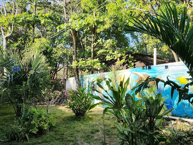 Relax and enjoy our beautiful murals and garden. A rarity in Tulum.