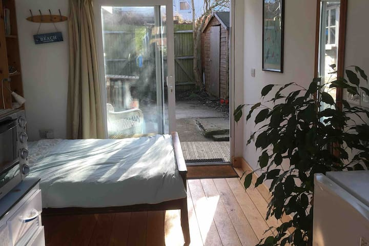 Self contained cabin; private patio; free parking
