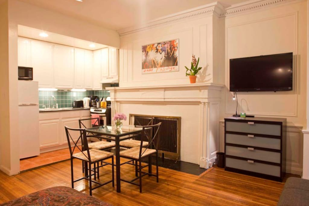 Kitchen and dining area featuring original decorative fireplace