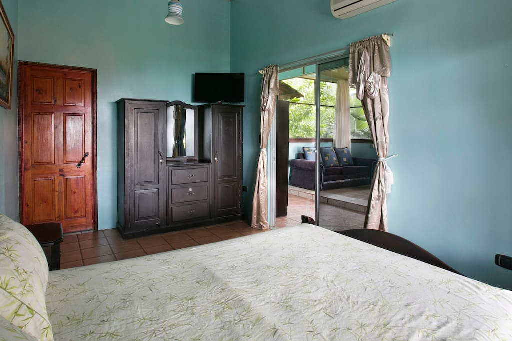 Large bedroom with flat screen TV