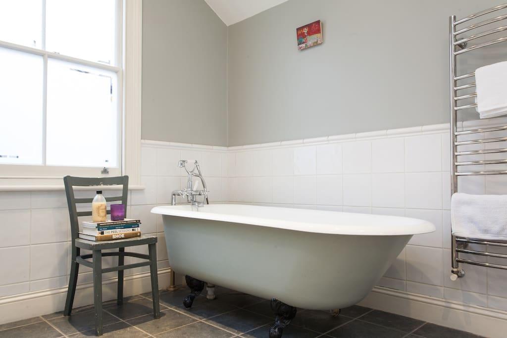 Bathroom with role top cast iron bath