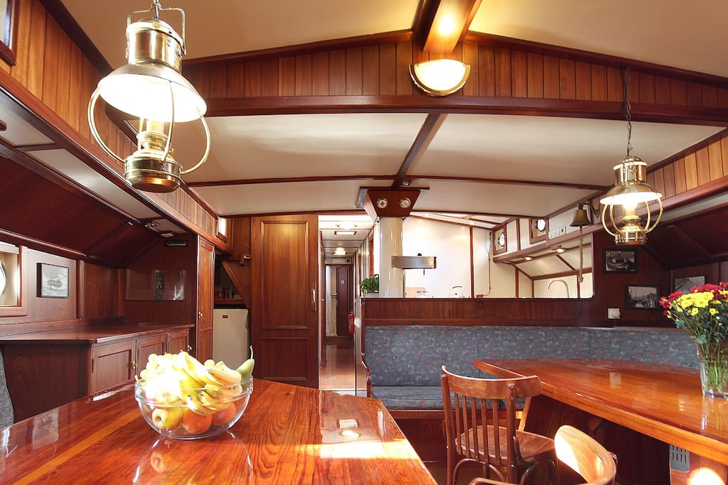 More than 100 year old sailing ship (refurbished in 1998 ;-) with cosy mess room, 5 cabins for max. 16 guests, 2 showers and toilets and of course central heating. Near the station and the city centre. You share the ship with other guests.
