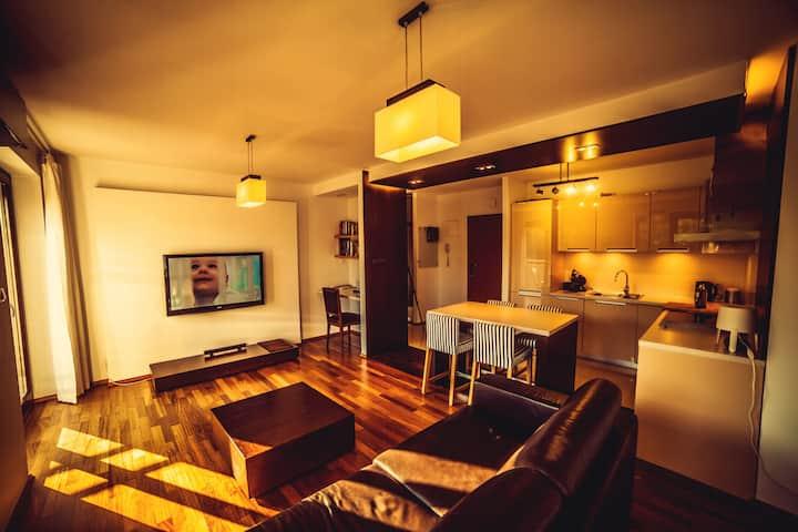 Zaciszny apartament z klimatyzacja i garażem