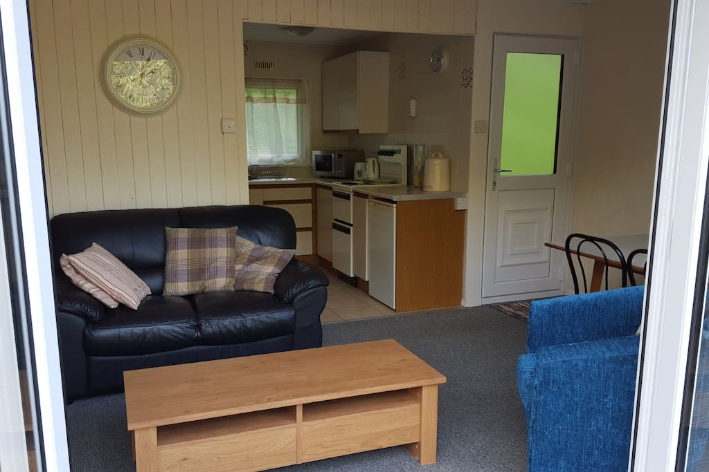 Sitting room with television and dvd, dining area