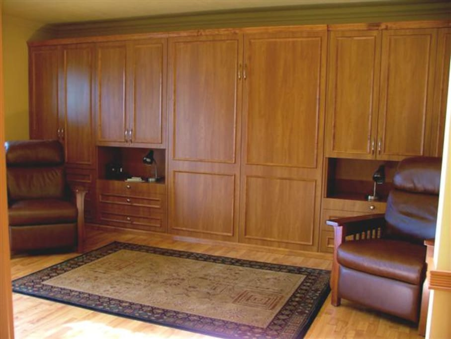 Queen size murphy  bed with built in closets and drawers.