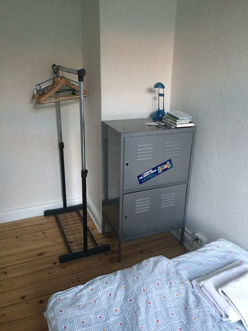 Hangers and a cupboard is available for storing clothes.