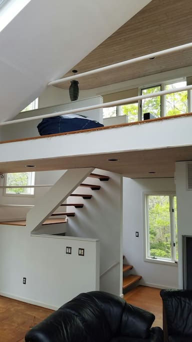 Staircase from living room to upstairs loft