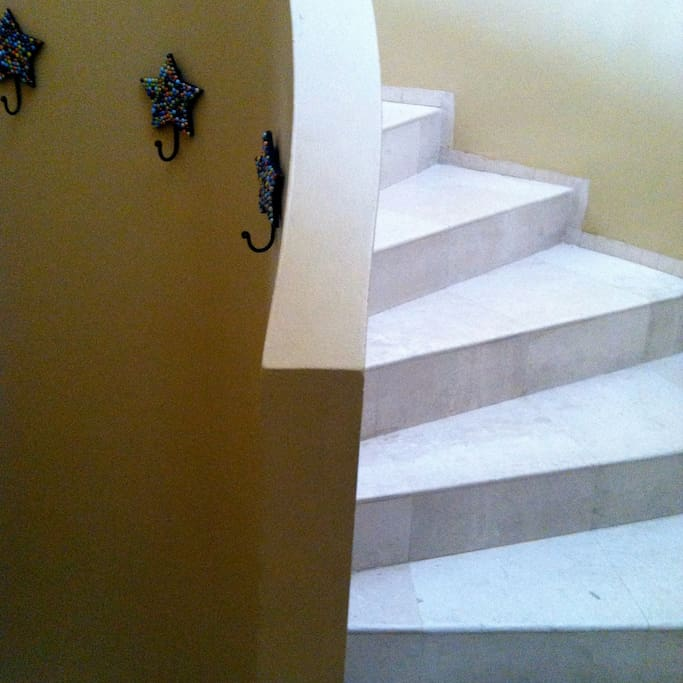 Circular stairway up to living areas from front door entry.