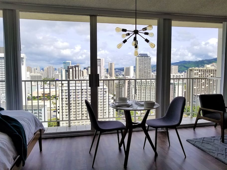 An amazing view of Waikiki city skyline through the floor to ceiling wall of windows that can be opened to enjoy the Hawaiian breeze.
