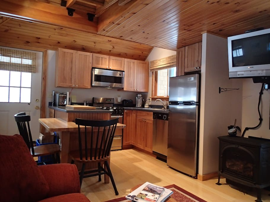 Warm, cozy living/kitchen/dining area
