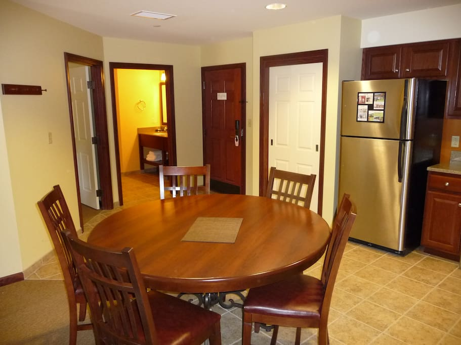Dining area for 8. Stainless steel appliances, granite counters.