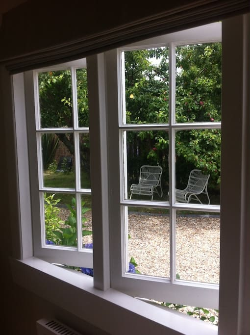 View of the plum tree and garden setting from the studio.
