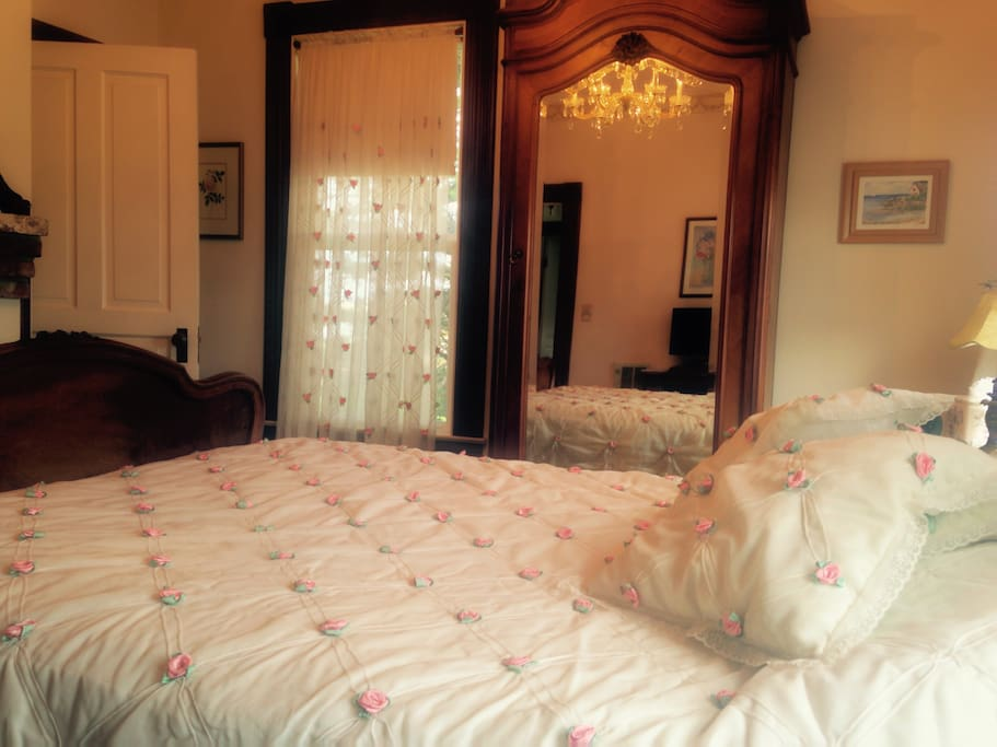 Queen bed, private bath with clawfoot tub, chandelier, fireplace and armoir.