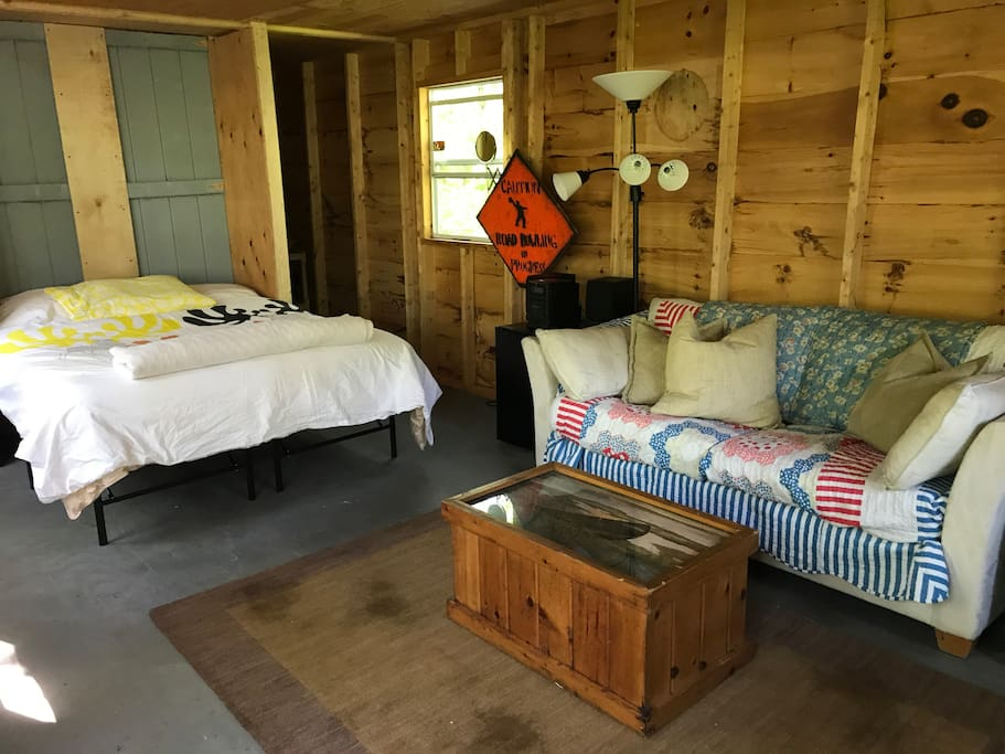 The cabin is essentially a studio with a private sleeping nook and a private  (curtained) bathroom.