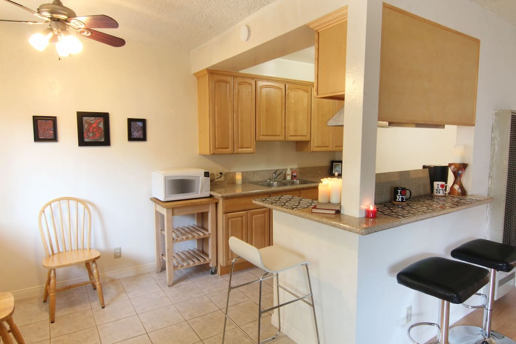 Modern remodeled kitchen features gas stove, microwave, stainless steel fridge and granite counters!