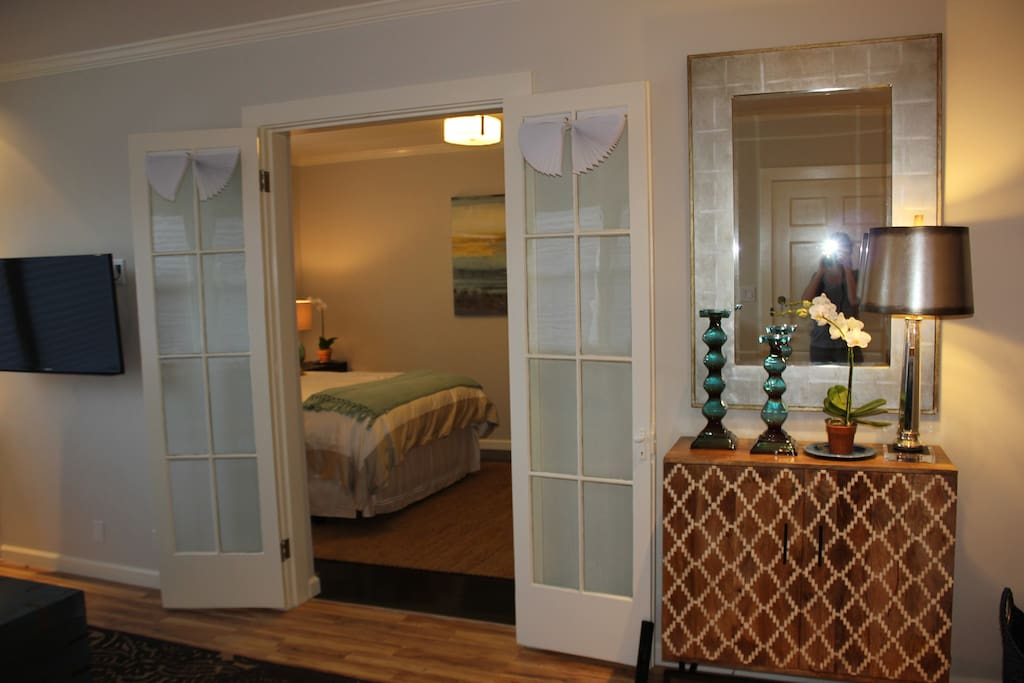 Open classic french doors for ease of access to living space or close for privacy