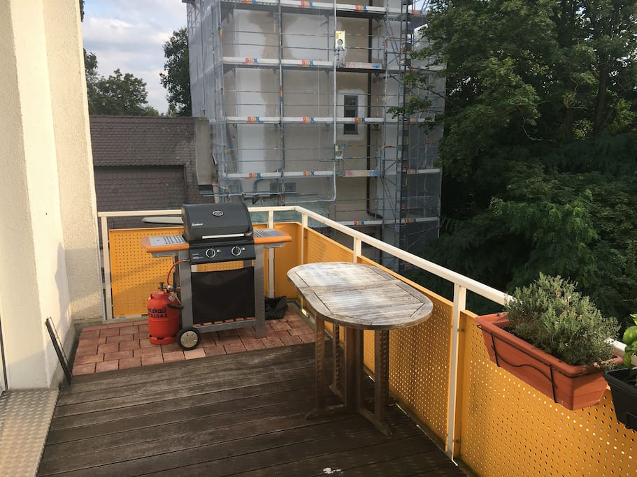 BBQ and spacious balcony accessible from guest room and lounge