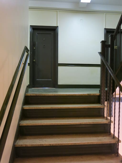 Pretty staircase to the apartment! There is also an elevator in case you have heavy suitcases!