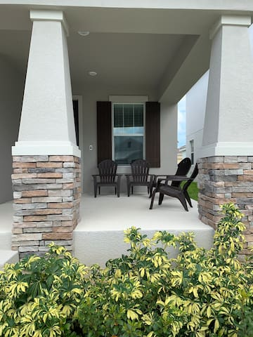 Expansive front patio with loungers