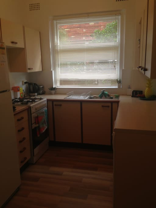 Fully equipped spacious kitchen also includes a washing machine and dishwasher