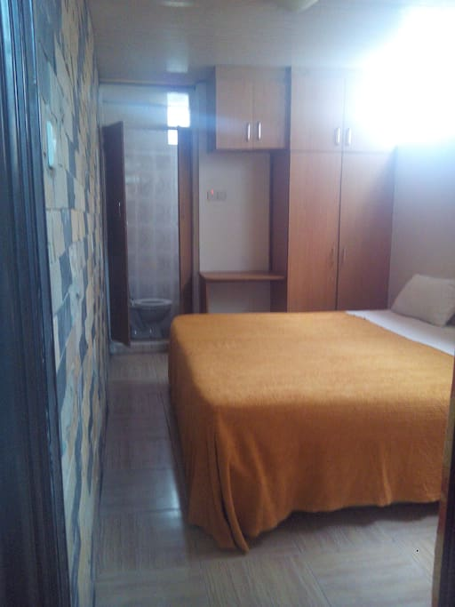 Kitui room features a 6*6 foot size and a single bed 3*6 foot with Mazeras and white wall accent. The room is self contained.