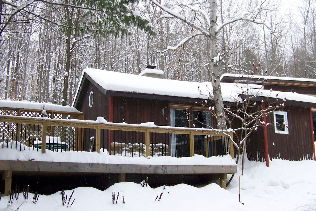A cozy cabin in the winter time.