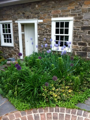 Front of guest house. Spring blooms.