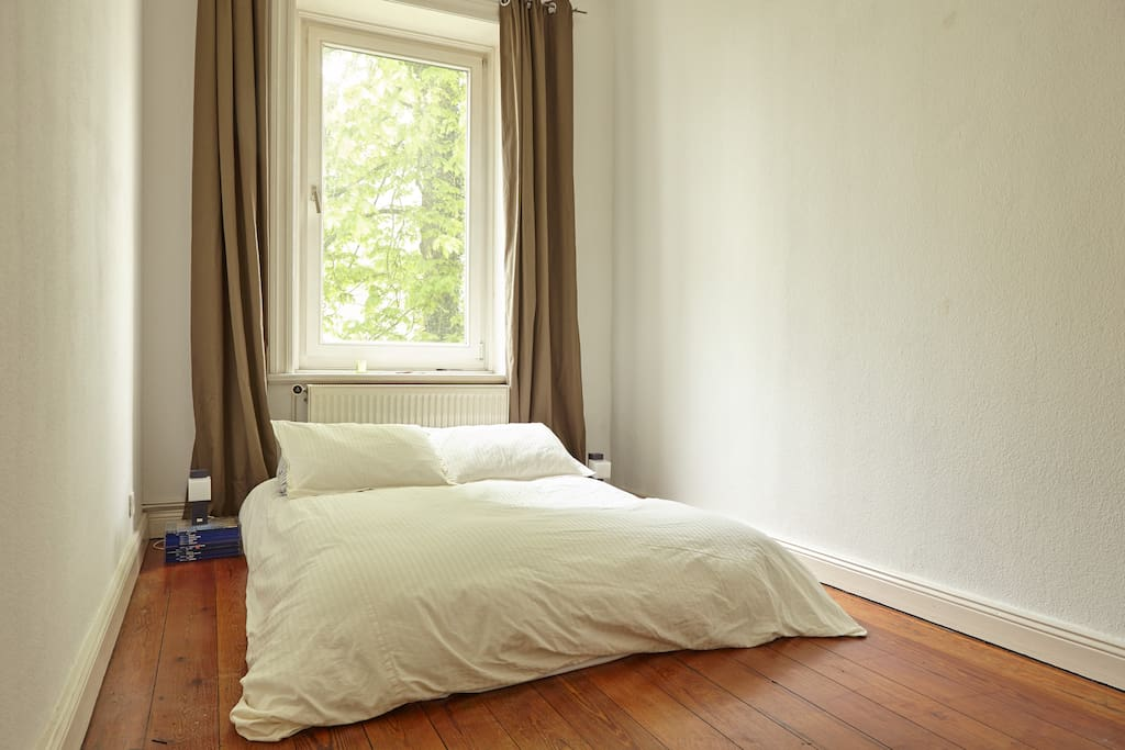 Guest-room situated in the back of the house overlooking a garden.