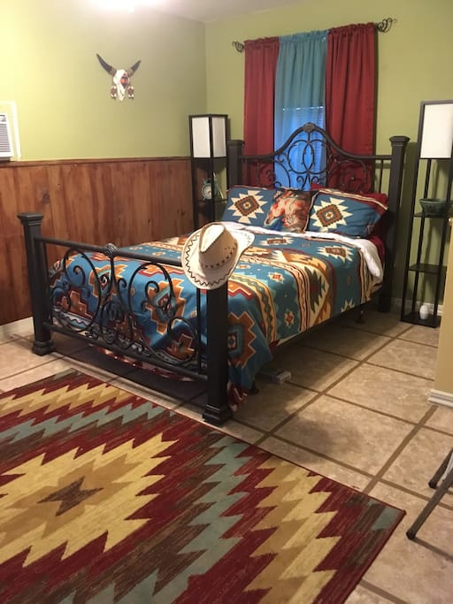 A view of the bed room from the sitting room area.