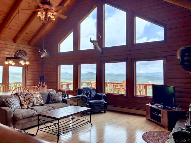 231SIM: INCREDIBLE VIEWS from this log cabin with large deck, huge yard, fire pit, hot tub, minutes from skiing, Santa's Village, and all that Northern New England has to offer! 1/4 mile to snowmobile trail.