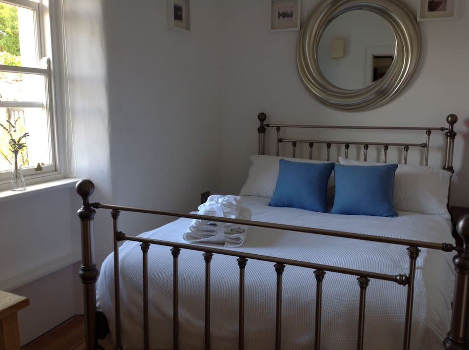 Charming double bedroom, white linen, fluffy towels with full ensuite bathroom