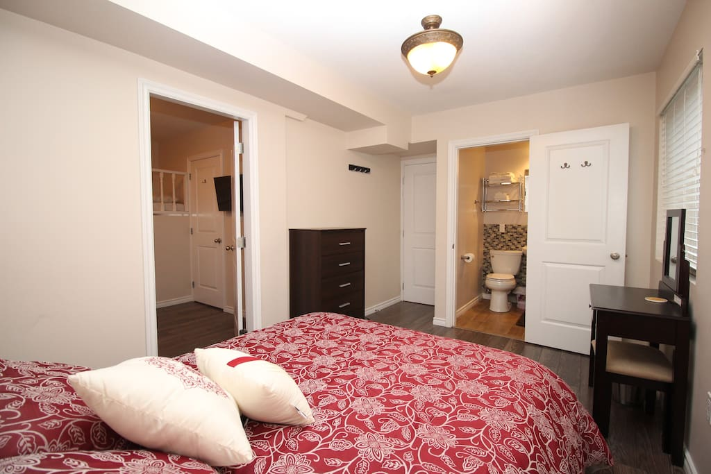 Next to this bedroom is a smaller room that includes a sofa bed and TV.