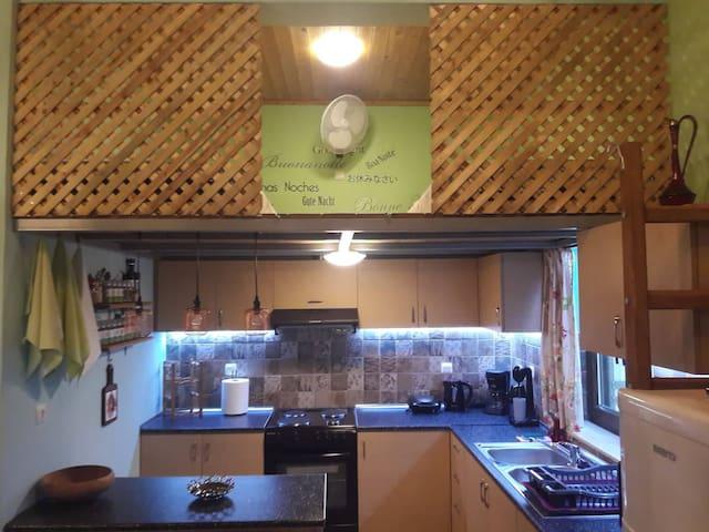 Kitchen & Upper Sleeping Area