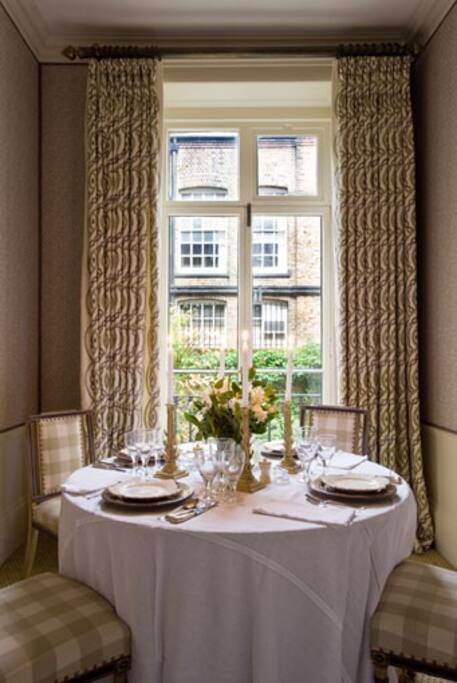 You can entertain guests or simply have a peaceful breakfast looking over the private garden in this beautifully decorated dining room