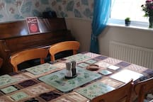 Shared Dining Room. The large table can be used for work, there is good WiFi and a power socket next to the table.