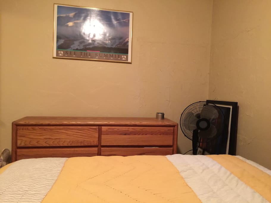 Dresser with two empty top drawers for clothes. You may rest your luggage on top of dresser.